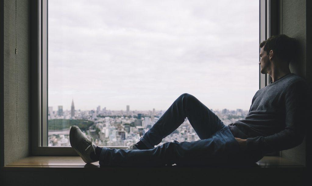 Introspective alone window guy